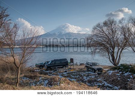 scenic landscape of Fuji mountain (Fujisan) in winter season beautiful snowcapped volcano and famous natural landmark of Japan view from Kawaguchi lake in Yamanashi Prefecture Japan