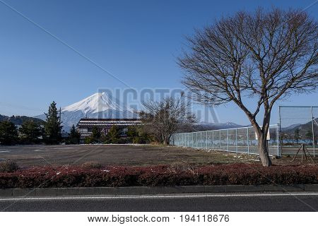 scenic landscape of Fuji mountain (Fujisan) and field in winter season beautiful snowcapped volcano and famous natural landmark of Japan view from Kawaguchi lake in Yamanashi Prefecture Japan