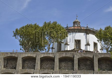 GAIA, PORTUGAL - AUGUST 7, 2015: People at a terrace in the exterior of the Monastery of Serra do Pilar World Cultural Heritage by UNESCO in Gaia Portugal.