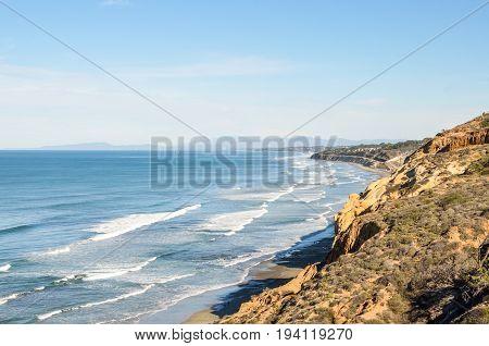 Torrey Pines cliff in pacific ocean in San Diego California with ocean waves