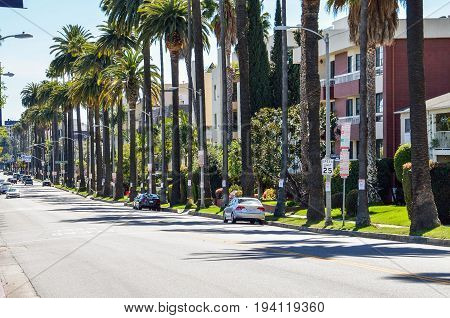Los Angeles USA - March 9 2014: Rangely Beverly street in downtown LA with residential houses and palm trees