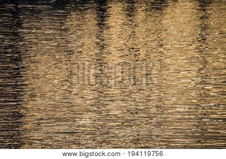 Reflection On Water During Sunrise In Harbor In Oxnard, California