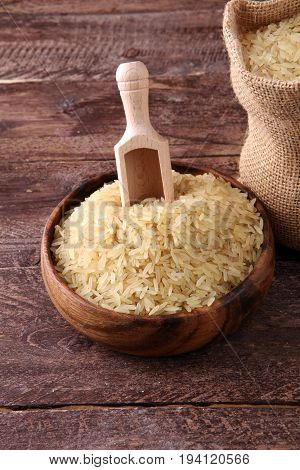 Rice, Indian Basmati, Pakistani Basmati Uncooked On Brown Backgr