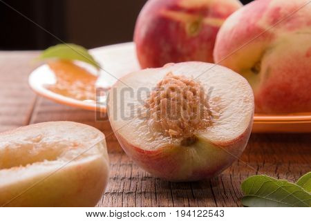 Peaches on a wooden background. Juicy peaches are on the table.