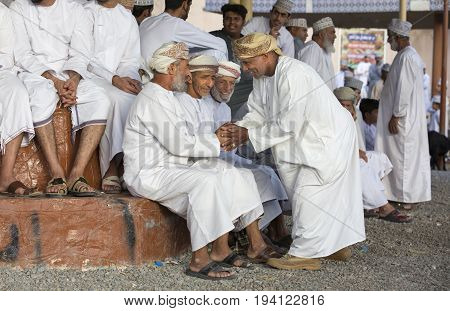 Nizwa Oman June 23rd 2017: omani men socialising at a Habta market before Eid al Fitr