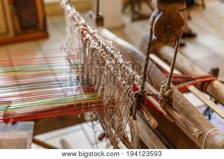 Close-up of ancient traditional hand weaving loom or weaving machine, selective focus