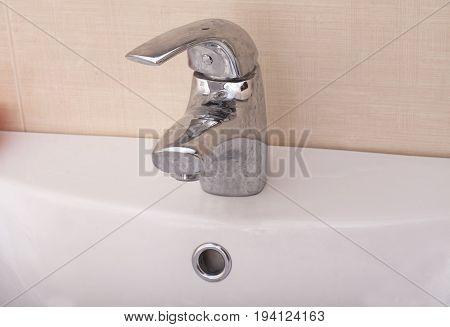Water crane in bathroom close up .