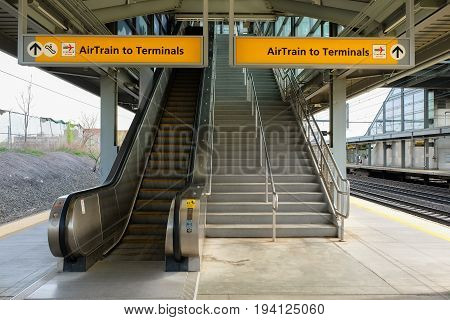 NEWARK, NEW JERSEY, USA - APRIL 25, 2016: Escalator and stairs at a platform of Newark Liberty International Airport train station
