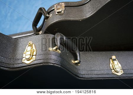 Сases from an acoustic guitar on blue background