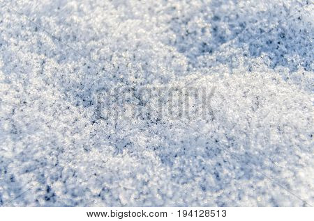 Macro closeup of heavy layer of snow ice crystals showing detail and texture on ground in winter
