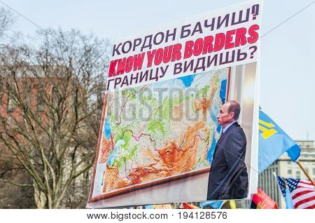 Washington DC USA - March 6 2014: People holding sign of Vladimir Putin and Russia during protest by White House