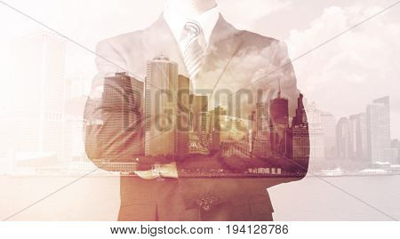 Businessman standing at cityscape background with warm light