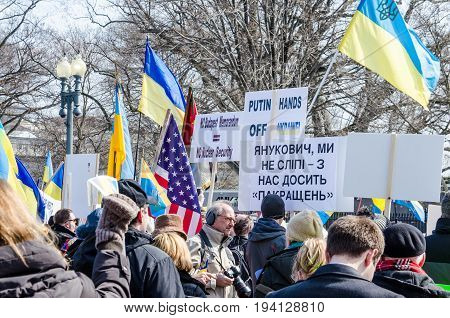Washington DC USA - March 6 2014: People holding sign of Vladimir Putin and Russia during Ukrainian protest by White House