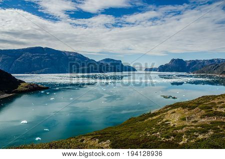 Small icebergs and reflections near a glacier Greenland