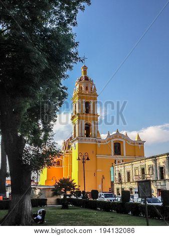 Bright Yellow Facade Of The San Apostolo Church