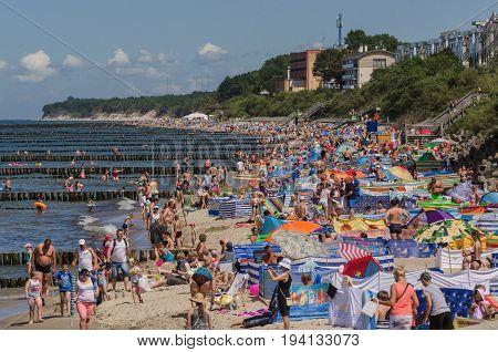 USTRONIE MORSKIE, WEST POMERANIAN / POLAND - 2017: Holiday day on the Baltic Sea beach