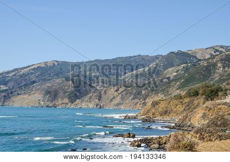 Central California coast with beach cliffs and blue ocean in Big Sur