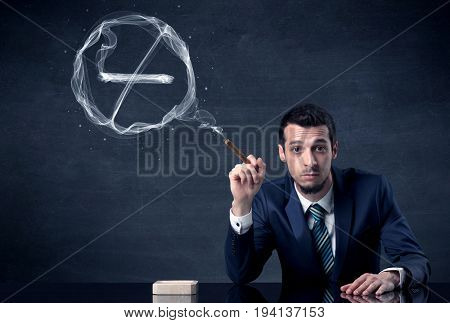 Businessman smoking cigarette and the smoke forms a no smoking sign.