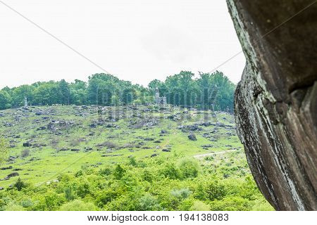 Gettysburg USA - May 24 2017: Little Round Top New York Monument in Gettysburg battlefield national park during summer with people