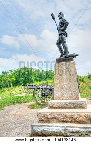 Gettysburg USA - May 24 2017: Battlefield park with closeup of Army of the Potomac Brigade sign and statue of soldier