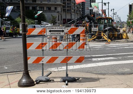 PHILADELPHIA, UNITED STATES - April 25, 2016: Road under construction and sign of sidewalk closed in Philadelphia, Pennsylvania, USA