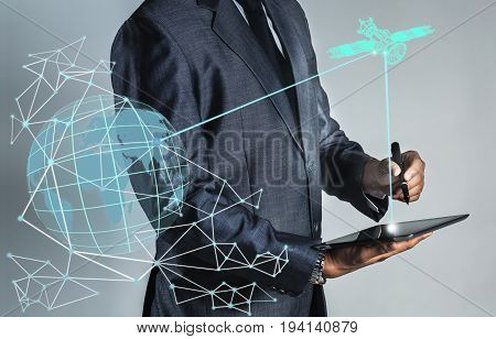 Businessman is sending data to satellite oprating system to global information. Internet of thing background.