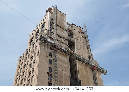 A building under renovation with a construction cradle