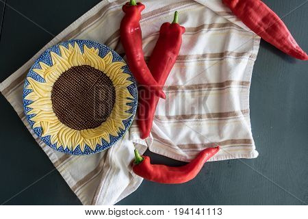Peppers with Sunflower Bowl on stripped towel