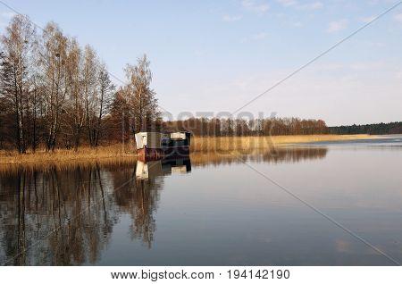 Ship on Netta river in Masuria, Poland.