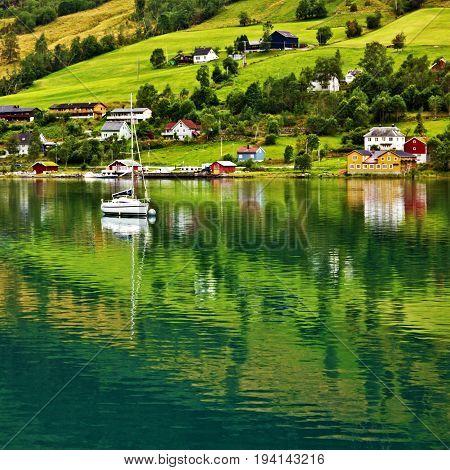 Norway, Olden village, green hills seaside landscape