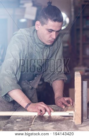 A Man Works On The Machine With The Wooden Product