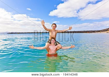 Boys Having Fun In The Clear Sea