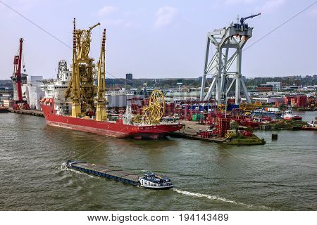 Rotterdam, Netherlands - July 7, 2017: Tanker and cargo vessels in sea port Rotterdam, Netherlands