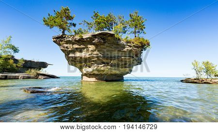 Turnip Rock on Lake Huron in Port Austin Michigan. An underwater view shows rocks under the clear surface of the water