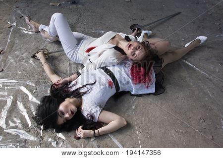 Crime Scene With Two Fashionable Women  In A Darkplace