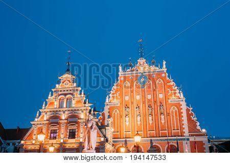 Riga, Latvia - Jule 1,2016: Riga Latvia. Schwabe House And House Of The Blackheads At Town Hall Square Ancient Historical Landmark And Popular Touristic Showplace In Summer Evening. Night Illuminations
