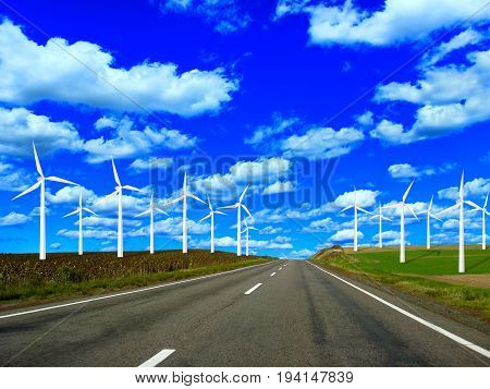 Wind power stand along the roadsides of highway and the blue sky. Electric power generation with windmills