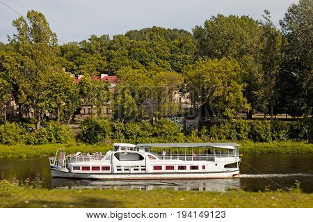 VILNIUS, LITUANIA - JULY 19, 2015: Old Town and the river Neris with ship, Vilnius, Lithuania.