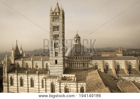 Italy Siena - December 26 2016: the view from facciatone of Duomo di Siena or Metropolitan Cathedral of Santa Maria Assunta on December 26 2016 in Siena Tuscany Italy.