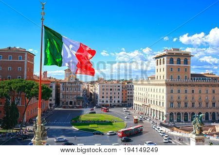 Rome, Italy - July, 1, 2017: veiw of Venice square in a center of Rome, Italy and state flag of Italy on the front background