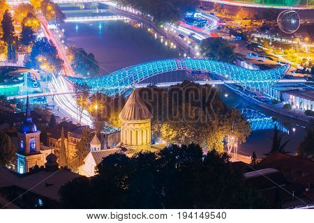 Tbilisi Georgia - October 21, 2016: Evening Night Scenic Aerial View Of Bridge Of Peace And Tbilisi Sioni Cathedral. Cathedral Of Saint Mary Of Zion. Street Night Illumination.