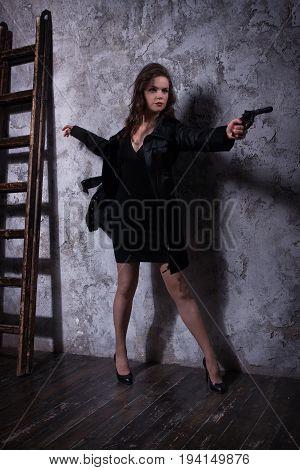 Noir Film Style Woman In A Black Suit