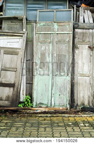 Many Old Wooden Doors Leaning Against Old Wooden Wall At Vintage Used Store