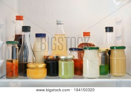Many different sauces in fridge