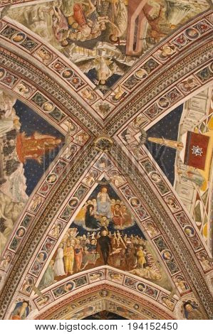 Italy Siena - December 26 2016: the view of the frescoes on the ceiling of San Giovanni Baptistery on December 26 2016 in Siena Tuscany Italy.