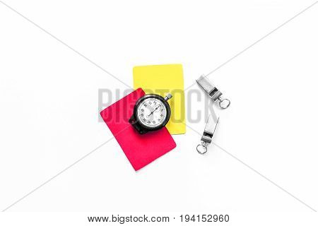 Football refereeing. Yellow and red referee cards, stopwatch, pad, on white background top view.