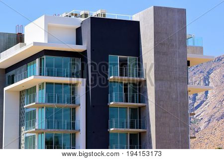 Contemporary style highrise residential building which overlooks the city and desert landscape taken in Palm Springs, CA