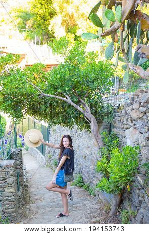 Smiling happy girl having fun during holidays in Cinque Terre