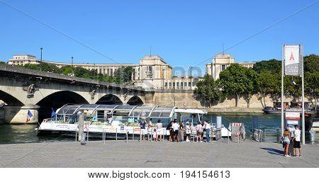 Tourists Wait To Board A Batobus In Paris