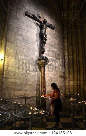 Candle Lighter In Notre Dame De Paris, France